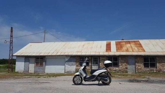 Scooter by Abandoned Tire Shop
