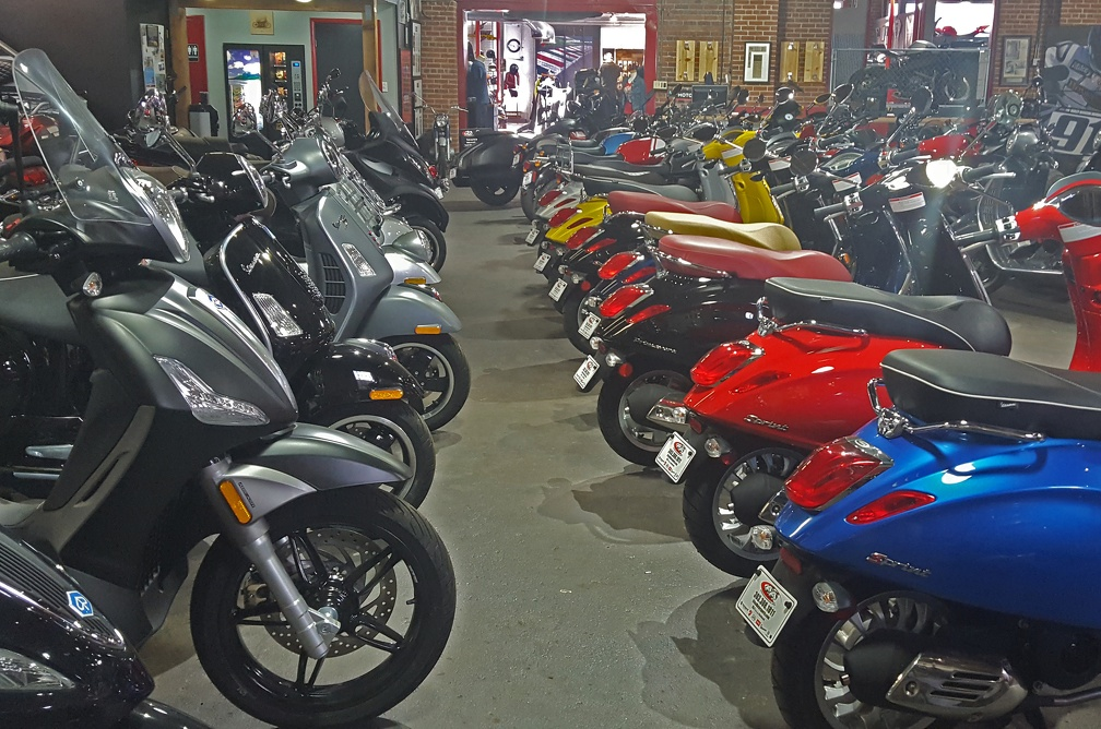 That's a fancy new BV350 in black on the left, and a row of colorful Vespas on the right.