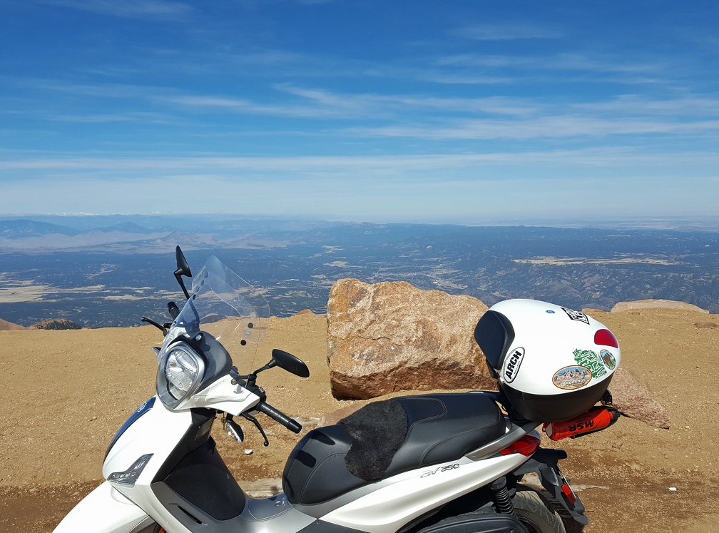 The mighty scooter conquers Pikes Peak! And only leaves a trail of coolant fluid the whole way.