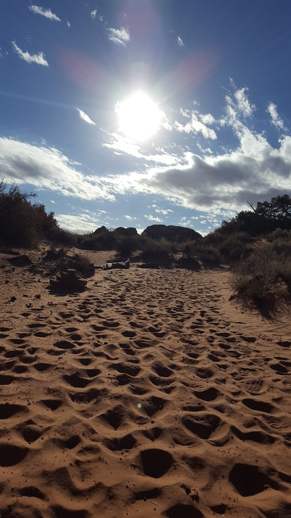 I love scrambling around the rock but hiking in the deep red sand is a slog.