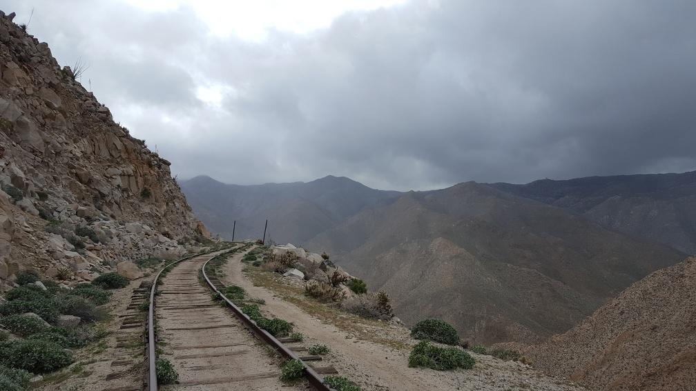 Railroad track along cliff's edge.